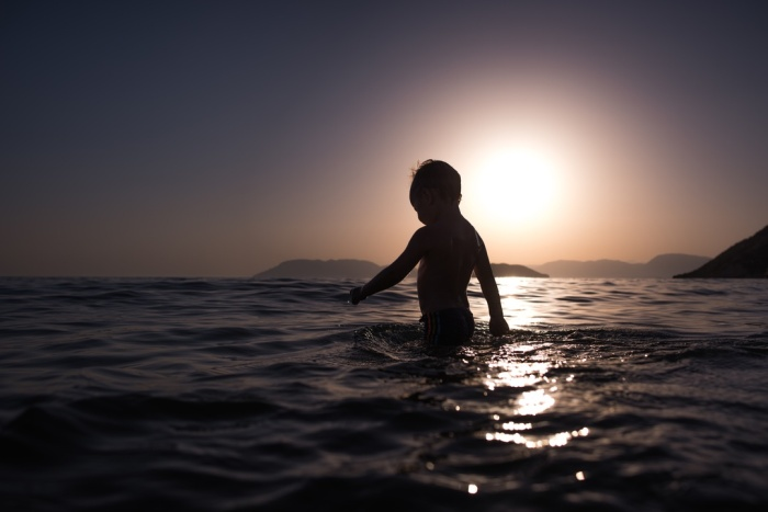 Child in the sea