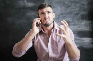 man in pink dress shirt angry calling pride emotion