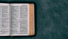 Picture of a bible on a green background