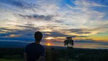 Joshua (me) enjoying the sunrise in our campsite
